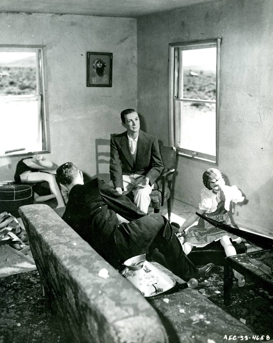 "The living room of ""House No. 2"" after an atomic weapons test, Nevada Proving Ground, Yucca Flat, Nevada.  ""House No. 2"" was positioned 7,500 feet away from the blast."