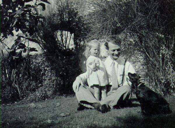 "Linda and Linus Pauling with their pet cocker spaniel, ""Til Eulenspiegel""."