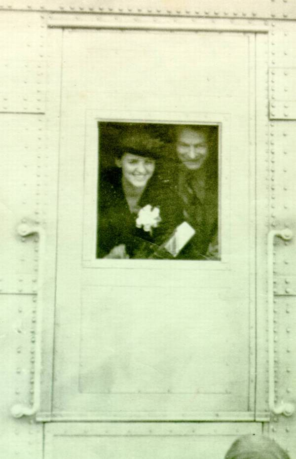 Ava Helen and Linus Pauling peeking through the window of the Union Pacific Streamliner City Of Los Angeles. Picture.
