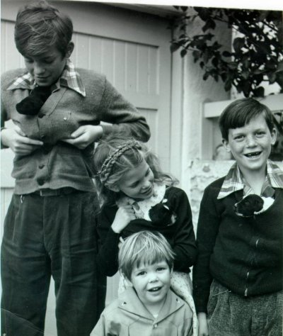 The Pauling children and their puppies. Picture. 1940