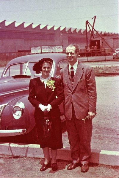 Ava Helen and Linus Pauling standing together outside [at a train station?]. Picture. 1948
