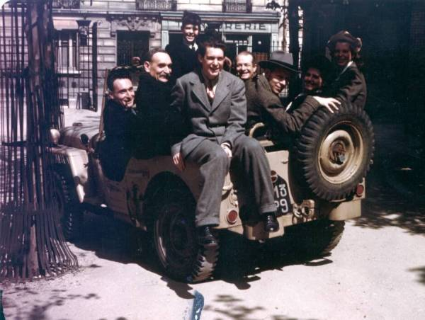 Members of the Pauling family crowded into a Jeep with Professor Bauer, Robert Millikan and others, Paris France. Picture. 1948