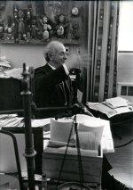 Linus Pauling gesturing in his Caltech office.