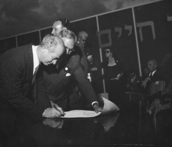 Linus Pauling signing the cornerstone scroll at the dedication ceremony for the Isaac Wolfson Building and the cornerstone laying for the Institute of Physics at the Weizmann Institute of Science. Rehovot, Israel.