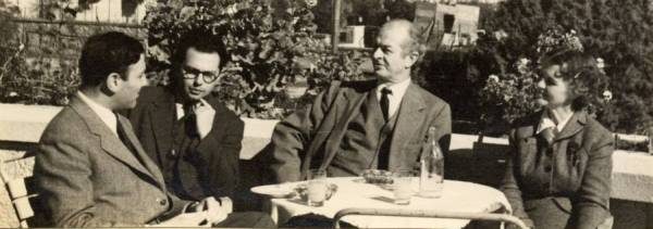 Heinz Henisch, Gabriel Stein, Linus Pauling and Ava Helen Pauling sitting outside the King David Hotel. Jerusalem, Israel.