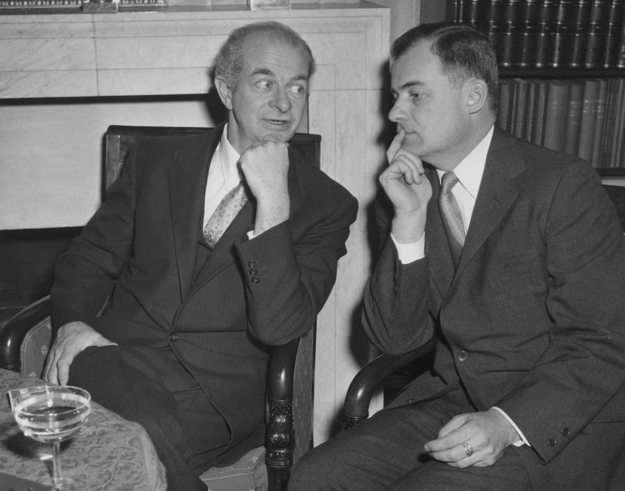 Linus Pauling sitting with Frederick C. Robbins at the 1954 Nobel Prize gathering. Stockholm, Sweden.