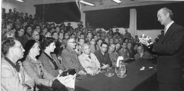 Linus Pauling, in lecture at The Hebrew University, Jerusalem, Israel.  Ava Helen Pauling is seated in the front row, second from left.