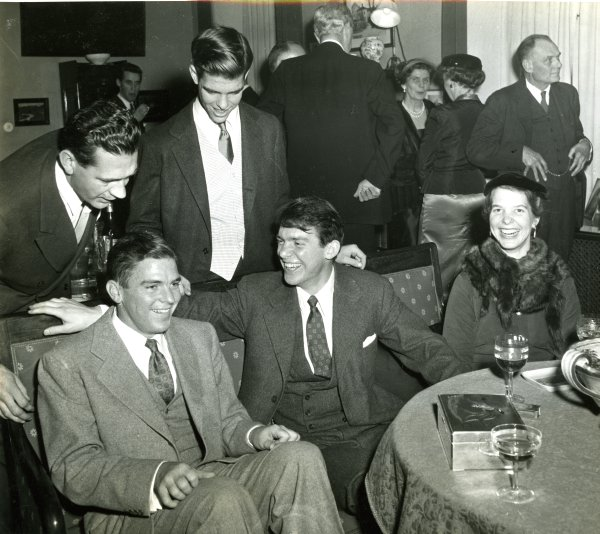 The Pauling children at a gathering in celebration of the 1954 Nobel Prizes. Stockholm, Sweden. Seated from left: Linus Pauling, Jr., Peter Pauling and Linda Pauling. Standing from left:  An unidentified individual and Crellin Pauling.