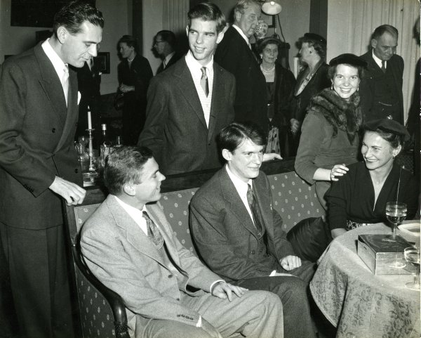 The Pauling children at a gathering in celebration of the 1954 Nobel Prizes. Stockholm, Sweden. Seated from left: Linus Pauling, Jr., Peter Pauling, Anita Oser Pauling and Linda Pauling. Standing from left:  An unidentified individual and Crellin Pauling.