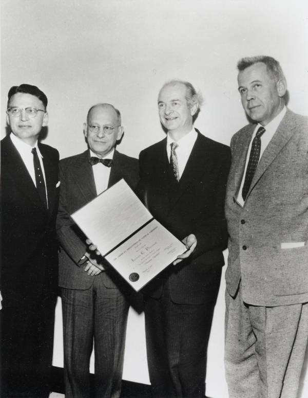Linus Pauling receiving an honorary membership to the American Association of Clinical Chemists. From left to right: Kenneth Johnson, Robert H. Hill, Pauling and William Bergren.