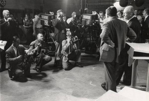 "Edward Teller and Linus Pauling with members of media and television crew during debate on fallout: ""The Nuclear Bomb Tests...Is Fallout Overrated?"" KQED-TV, San Francisco."
