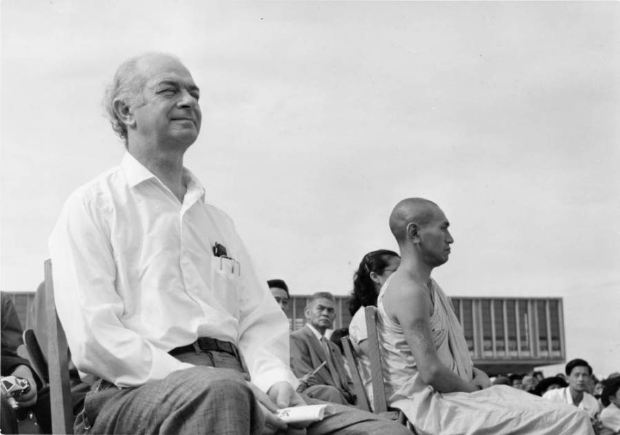 Linus Pauling sitting next to a Buddhist monk, Hiroshima, Japan.