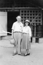 Linus and Ava Helen Pauling standing outside Dr. Albert Schweitzer's mission hospital, Lambéréne, Gabon.