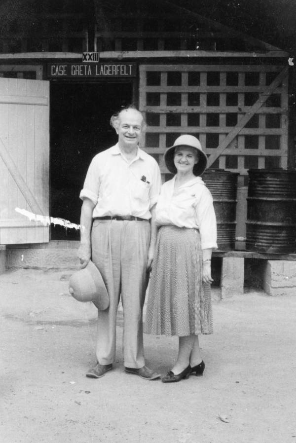Linus and Ava Helen Pauling standing outside Dr. Albert Schweitzer's mission hospital, Lambéréne, Gabon.Picture. 1959
