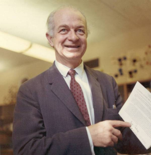"Linus Pauling holding a copy of ""An Appeal to Stop the Spread of Nuclear Weapons""."