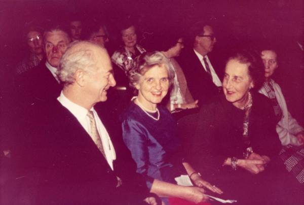 Linus and Ava Helen Pauling speaking with an unidentified woman at the Nobel Hall, Oslo, Norway.