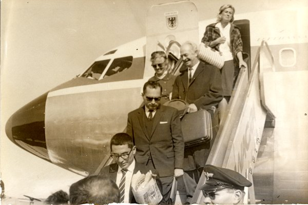 Linus Pauling and Ava Helen Pauling disembarking from an airplane. Buenos Aires, Argentina. Picture. 1963