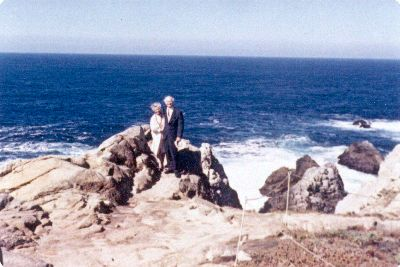 Linus and Ava Helen Pauling at the top of an oceanside cliff. Picture. 1963