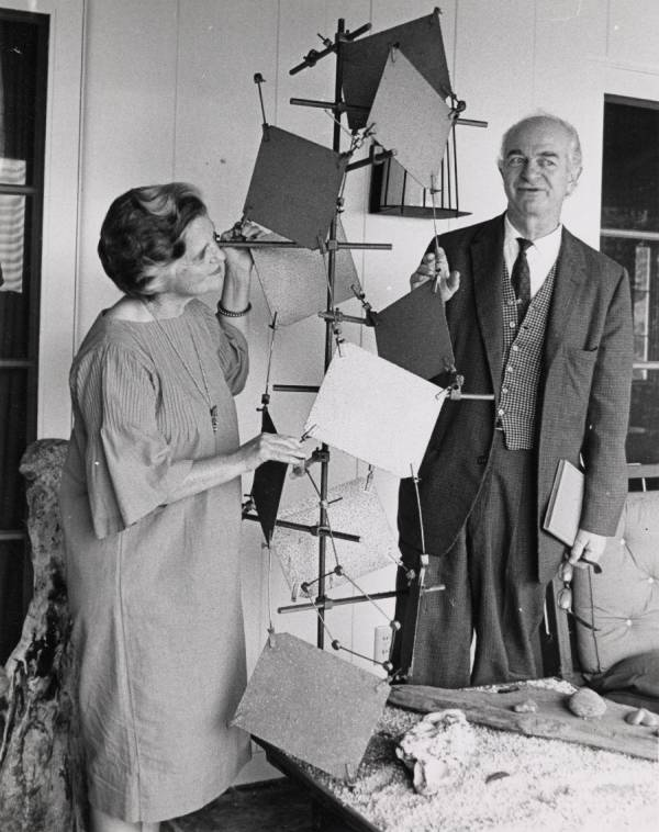 Ava Helen and Linus Pauling standing next to a large chemical model. [the alpha-helix?]
