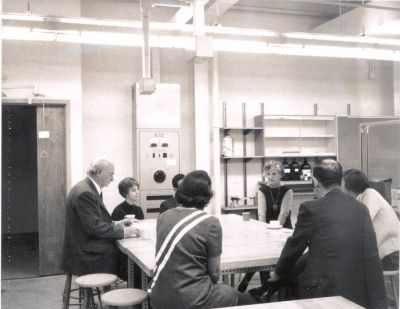 Linus and Ava Helen Pauling among a group drinking coffee in a Wilson College laboratory. Picture. April 14, 1969