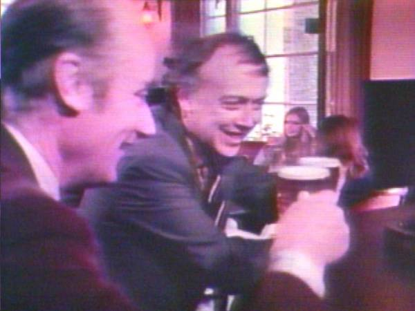 Francis Crick and James Watson exchanging a toast in a British pub.