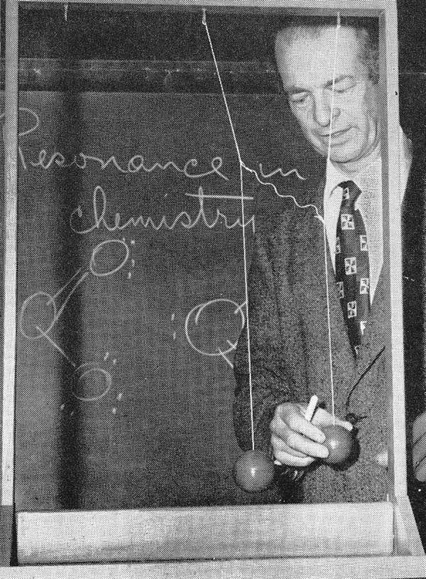 Linus Pauling manipulating a molecular model used to illustrate the process of chemical bonding.
