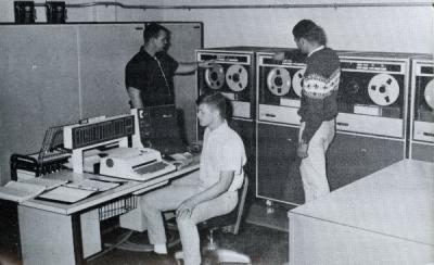 "<p>Image from a brochure titled ""Preparing for a Career in Agricultural Economics."" Caption below photo reads: ""Learning to use electronic computers plays an increasingly important part in the training of agricultural</p><p>				economists.""</p>"