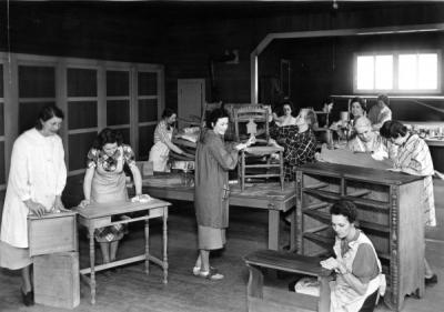 Home Economics students refinishing furniture, 1940s.