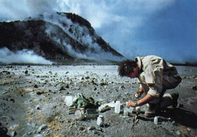 Dr. John Baross, a researcher at Oregon State University, taking samples to study from an area near the Mount St. Helens eruption site.