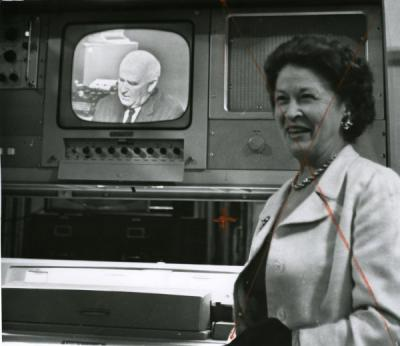 An unidentified women in front of a television studio monitor showing UPI Chief Frank Bartholomew, 1960.
