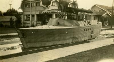 "Photograph annotated: ""Our prize winning float for Homecoming. Fall Term, 1927."""