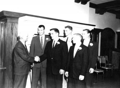 Blue Key initiation, ca. 1956. Dean Lemon shaking hands with Jim Long, John Narver, Bruce Roberts, Ivan Wood, and Cliff Kuhlman.