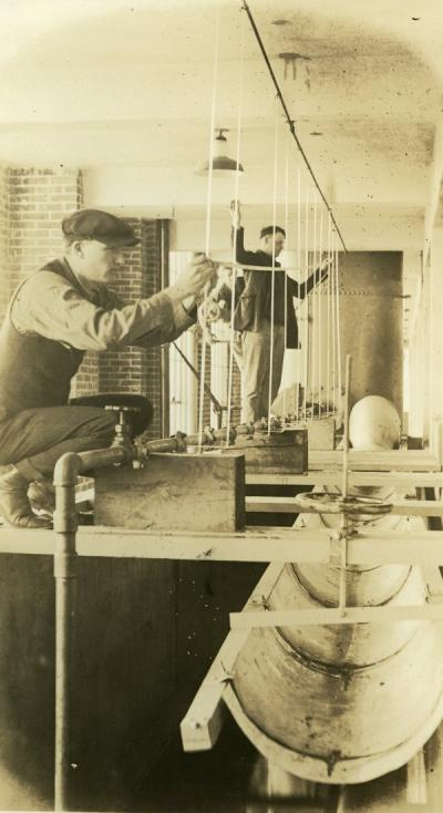 Image depicting a test for friction in pipes, ca 1920s.