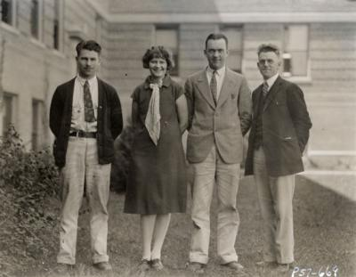 OSC Journalism staff with Portland correspondents. Pictured from left to right are Webley Edwards, Eunice Rydman, A. Lowell McMillian and John C. Burtner.
