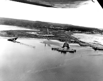 Aerial view of Newport, Oregon including Hatfield Marine Science Center and Research Vessel Yaquina, 1969.