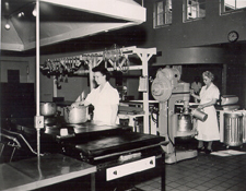Campus cooks, 1950. This photograph depicts a typical day for the dedicated cooks who created the meals for hungry students. The kitchen was at Sackett Hall.