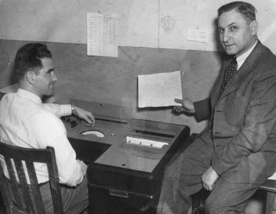 <p>Dr. Robert R. Reichart and Lawrence W. Carrillo, Jr. using a machine to check tests for the counseling and testing service, 1949. Robert R. Reichart received a B.S. in Commerce from Oregon State University in 1917 and</p><p>				retired in 1974 as a Professor Emeritus of both Education and Forestry. Reichart taught courses in educational psychology, his focus centered on a student's ability to learn on their own using multimedia resources.</p><p>				Eventually Reichart created a center for self-learning on campus.</p>