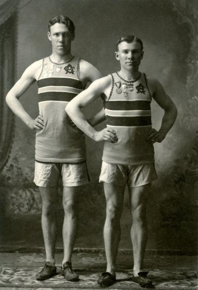 OAC track athletes. W. H. Davolt stands on the left.