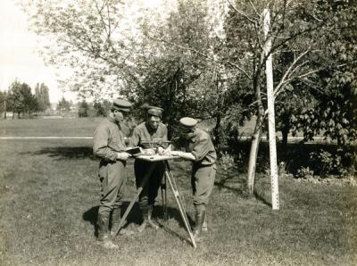 Students in a civil engineering surveying class demonstrating plane table topography, 1914.