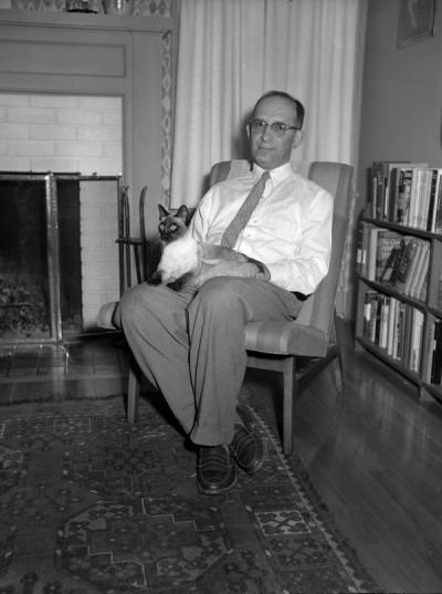 <p>Bernard Malamud sitting with a cat, ca. 1960. Malamud was an English professor at Oregon State College from 1949 to 1961. During this time he wrote three novels: The Natural (1952), The Assistant (1957), and A New Life</p><p>				(1961) as well as a collection of short stories, The Magic Barrel (1959) for which he received the National Book Award. He was presented OSU's Distinguished Service Award in 1969.</p>