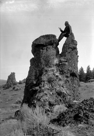 Joseph Luxello, Yakima Indian missionary, sitting on Pulpit Rock near The Dalles, Oregon, ca. 1900.