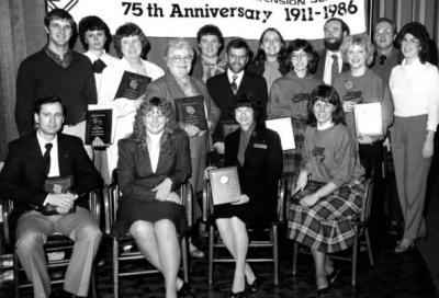 "<p>OSU Extension Association ""Pursuit of Excellence"" award winners, 1986. Winners were (standing l-r) Craig Riggert, Teresa Hogue, Gloria Shibley, Wanda Phipps, Evelyn Brookhyser, Erric Ross, Debra Driscoll, Nancy Kershaw,</p><p>				Greg Wheeler, Mary Dilworth Stewart, Larry Burt, Susan Roy Baumgartner; (sitting l-r) Dick Best, Becky Pettit, Linda Erickson, and Miriam Lowrie.</p>"