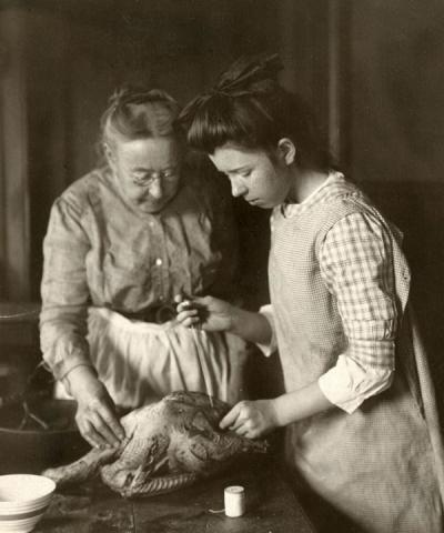 An unidentified woman and girl preparing a goose, 1915.