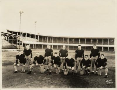 "<p>The Ironmen Football team, October 1933. Front row: Charles Woodrow ""Woody"" Joslin, Adolph Schwammel, Clyde Devine, William Tomsheck, Harry Field, Victor Curtin. Back row: Vernon Wedin, Harold Joslin, Norman ""Red""</p><p>				Franklin, James ""Pierre"" Bowman, Harold Pangle.</p>"