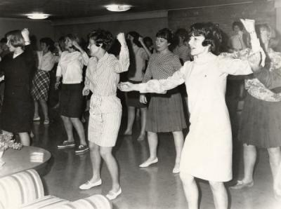 Chi Omegas at the Inter-fraternity Council Sing practice, ca. 1960s.