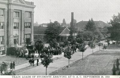 "Postcard reading ""Train loads of students arrive at O. A. C. September 28, 1918."""