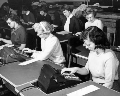 Students using calculators in an office procedures class, 1951.