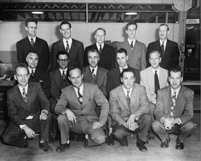 <p>Oregon Forest Products Laboratory staff, ca. 1949. Front Row, left to right: Hugh Wilcox, Murl Peterson, Bruce Anderson, James Holden. Center Row, left to right: Paul Dunn, Phimister Proctor, Ervin Kurth, Mortimer</p><p>				Macdonald, Leif Espenas. Back row, left to right: Bruce Wagg, Robert Stillinger, Maurice Gekeler, Robert Graham, William Baker.</p>