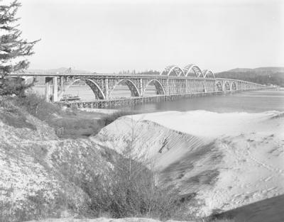 Image documenting the final stages of construction on the Alsea Bay Bridge, designed by Conde McCullough, ca. 1936.