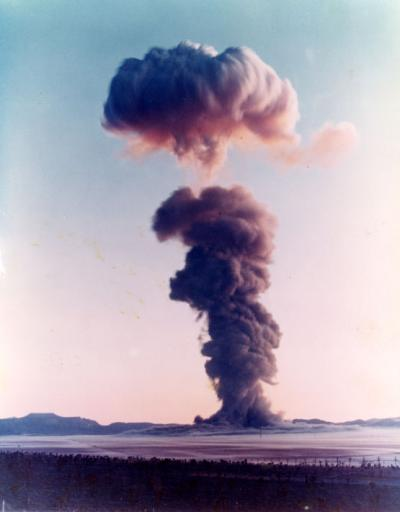 Color photograph of an [early morning?] bomb test at an American Southwest test site, ca. 1960s.